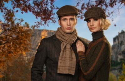 Elegant couple in caps against autumnal landscape Fall fashion